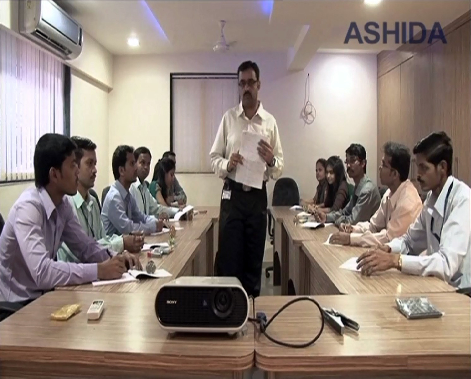 Ashida electronics employees doing meeting
